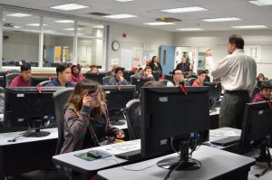 instructor and students inside a computer lab