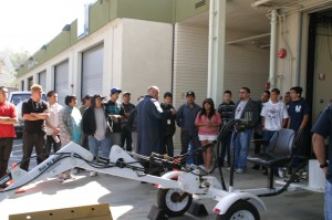Instructor demonstrating machinery to students