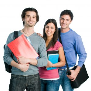 group of students holding books smiling