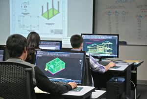 students designing a house in computers