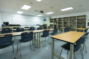 empty classroom with machinery tools on shelves