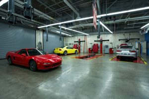 red, yellow and gray cars in automotive lab