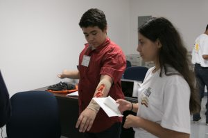 two students learning how to cure a wound