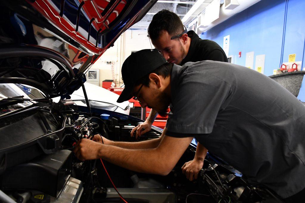 Tesla students doing diagnostics
