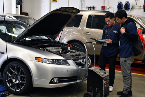 Students running diagnostic on the car