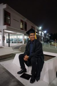 Picture of Marvin Contreras in cap and gown.