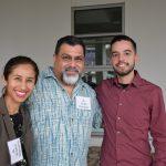 Group picture of mentors Viviana Villanueva, Jorge Huinquez, and Martin Gonzalez posing outside LR building.