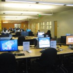 Photo of the library computer lab, showing computers and students working