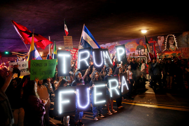 Demonstrating in Barrio Logan in San Diego after the election with a message of Trump Out