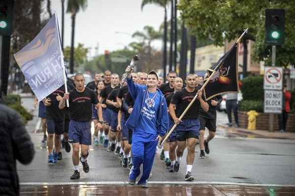 Special Olympian Luke Rose of Northridge leads cadets from the Rio Hondo College Police Academy in a run through San Fernando in honor of fallen San Fernando Police officer Jesse Paderez who died in the line of duty in 2002. Photo by David Crane, Los Angeles Daily News - SCNG