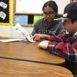 2 kids being tutored