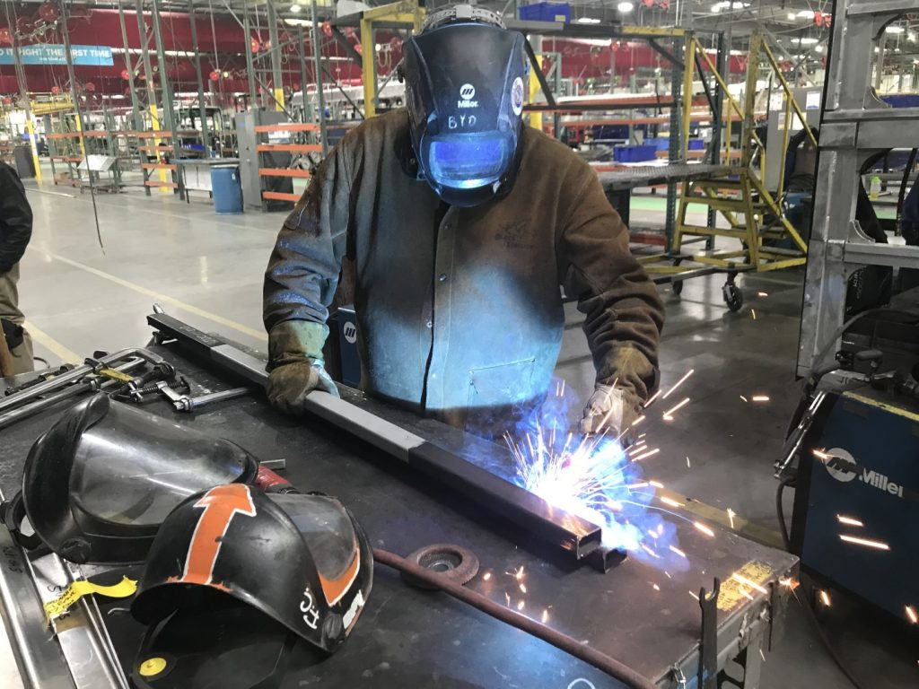 Edward McKee welds a piece for an electric bus at the BYD Coach & Bus manufacturing facility in Lancaster.