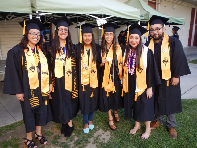 Transfer students posing for photo during 2015 commencement